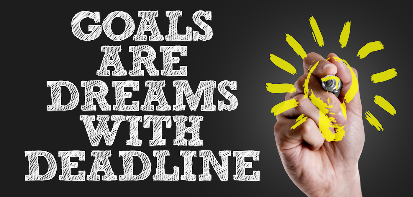 Hand writing the text: Goals Are Dreams With Deadline