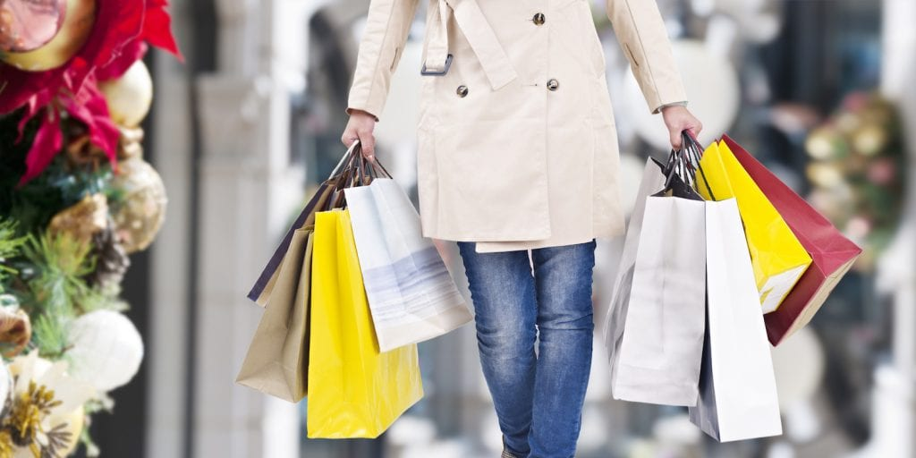 woman holiday shopping with bags in hand