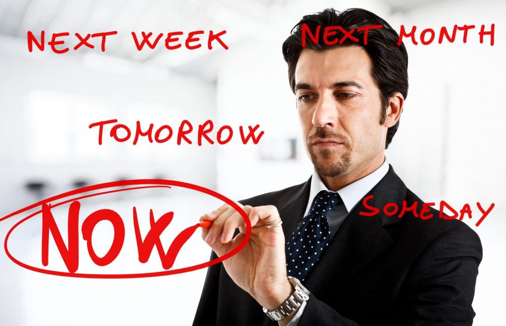 Business man figuring a way to stop procrastinating