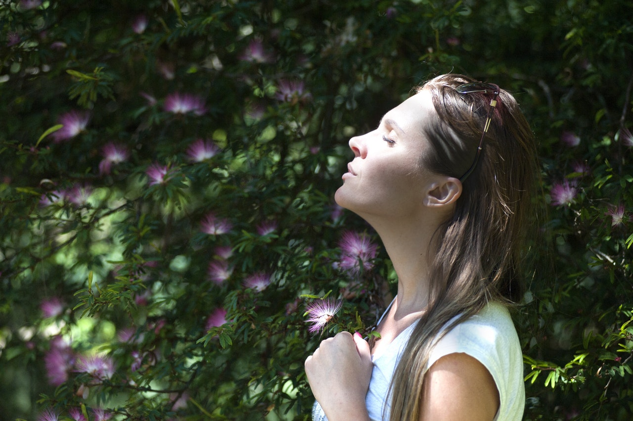 woman taking deep breaths