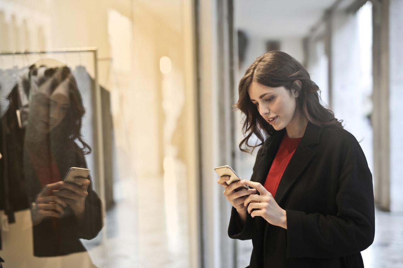 woman using phone while walking