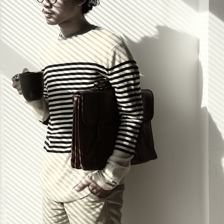 Young man wearing stripes sweater