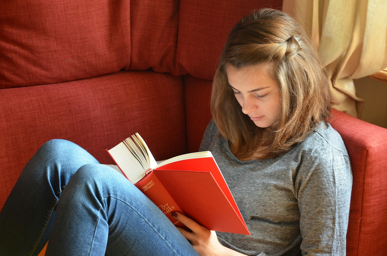 teen reading a book to learn something new
